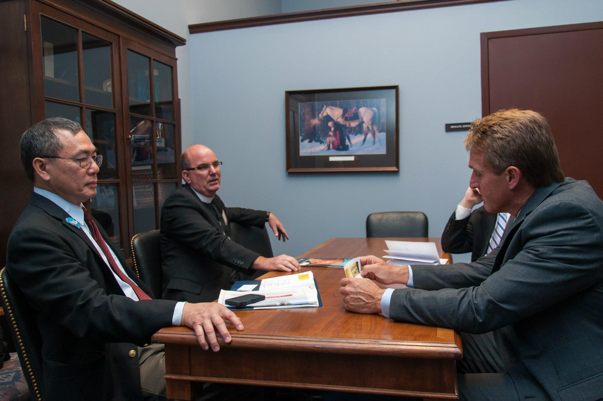 Lutheran leaders meet with Senator Flake. L-R: Chak Ng, Bishop Steve Talmage, Senator Jeff Flake